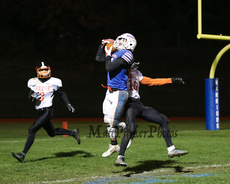Winnacunnet's WR #8 Liam Viviano catches the ball in the end zone for a touch down off a Patrick MacDougall pass with Blackbirds #16 Marcin Maleski unable to break up the pass with #3 Michael Abreu covering during Friday Night's NHIAA DIV I football game between Winnacunnet and Keene High Schools on 10-28-2016 @ WHS.  Matt Parker Photos
