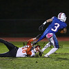 Winnacunnet's RB #3 Billy Powers drags Blackbirds #16 Marcin Maleski up the field while running for a first down during Friday Night's NHIAA DIV I football game between Winnacunnet and Keene High Schools on 10-28-2016 @ WHS.  Matt Parker Photos