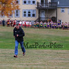 "Winnacunnet's coach Richard, ""Ozzie"" Osborne makes his way up the course as the Boys line up for the start of the Boys race at the NHIAA DIV I Cross Country Championships on Saturday 10-29-2016 @ Derryfield Park, Manchester, NH.  Matt Parker Photos"