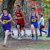 Winnacunnet's #897 Noah Taracena makes the last turn at the maple tree as he heads into the finish line in the Boys race at the NHIAA DIV I Cross Country Championships on Saturday 10-29-2016 @ Derryfield Park, Manchester, NH.  Matt Parker Photos