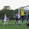 Titans Goal Keeper #1 Isabel Dunning jumps to make a save off a Winnacunnet corner kick with Winnacunnet's #21 Caroline Meuse getting position to make a play during Monday's NHIAA DIV I Girls Soccer game between Winnacunnet and Nashua North High School on 10-3-2016 @ WHS.  Matt Parker Photos