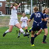 Winnacunnet's #21 Caroline Meuse jumps to block a kick by Titans defender #10 Erin Cunningham during Monday's NHIAA DIV I Girls Soccer game between Winnacunnet and Nashua North High School on 10-3-2016 @ WHS.  Matt Parker Photos