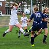 Winnacunnet's #21 Caroline Meuse jumps to block a kick by Titans defender #10 Erin Cunningham during Monday's NHIAA DIV I Girls Soccer game between Winnacunnet and Nashua North High School on 10-3-2016 @ WHS.  Matt Parker Photos