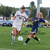 Winnacunnet's Forward #20 Leah Orzechowski works to move the ball past Titans Defender #2 Emily conners during Monday's NHIAA DIV I Girls Soccer game between Winnacunnet and Nashua North High School on 10-3-2016 @ WHS.  Matt Parker Photos