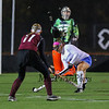 Winnacunnet's #8 Kelly Mackechnie clears the ball with Goal Keeper #32 Nikki Tredwell covering the goal and Timberlane's #11 Kylie Fitzpatrick looking to make a stop during the NHIAA DIV I Field Hockey Championships on Sunday 10-30-2016 @ Bedford HS.  Matt Parker Photos