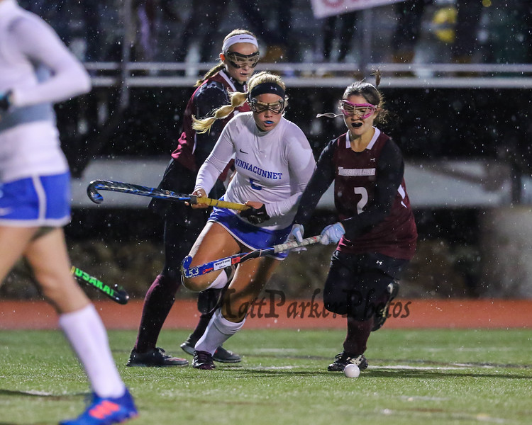 Winnacunnet's #5 Isobel Sargent works the ball around Timberlane defender #2 Joy Steenson during the NHIAA DIV I Field Hockey Championships on Sunday 10-30-2016 @ Bedford HS.  Matt Parker Photos
