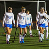 Winnacunnet Field Hockey players #5 Isobel Sargent, #6 Abby Merrill, #7 Rachel Ingham lead their team mates off the field after Winnacunnet's loss to Timberlane in the NHIAA DIV I Field Hockey Championships on Sunday 10-30-2016 @ Bedford HS.  Matt Parker Photos