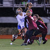 Winnacunnet's #12 Lauren Alkire gets pressure from Timberlane's #4 Victoria Rothwell and #8 Julia Mulhall during the NHIAA DIV I Field Hockey Championships on Sunday 10-30-2016 @ Bedford HS.  Matt Parker Photos
