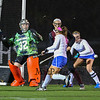 Winnacunnet's Goal Keeper #32 Nikki Tredwell watches as a Timberlane shot goes across the front of the goal with Winnacunnet's #8 Kelly Mackechnie and #6 Abby Merrill defending with Timberlane's #11 Kylie Fitzpatrick during the NHIAA DIV I Field Hockey Championships on Sunday 10-30-2016 @ Bedford HS.  Matt Parker Photos