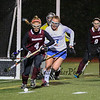 Winnacunnet's #12 Lauren Alkire hustles after the ball with Timberlane's #4 Victoria Rothwell during the NHIAA DIV I Field Hockey Championships on Sunday 10-30-2016 @ Bedford HS.  Matt Parker Photos