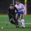 Winnacunnet's #24 Dailynn Annis puts pressure on Timberlane's #9 Rachel Paradis during the NHIAA DIV I Field Hockey Championships on Sunday 10-30-2016 @ Bedford HS.  Matt Parker Photos
