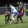 Winnacunnet's #12 Lauren Alkire's progress  is stalled by timberlane's #14 Julia Lanctot with #8 Julia Mulhall during the NHIAA DIV I Field Hockey Championships on Sunday 10-30-2016 @ Bedford HS.  Matt Parker Photos