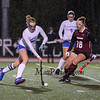 Winnacunnet's #6 Abby Merrill runs the ball up the field with Timberlane's #18 Taryn Mackinnon defending at the NHIAA DIV I Field Hockey Championships on Sunday 10-30-2016 @ Bedford HS.  Matt Parker Photos