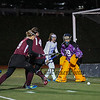 Timberlane's goal Keeper #99 Makayla Livingston watches with Winnacunnet's #15 Brileigh April as the ball goes wide on a Winnacunnet shot on the Timberlane goal during the NHIAA DIV I Field Hockey Championships on Sunday 10-30-2016 @ Bedford HS.  Matt Parker Photos