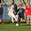 Winnacunnet's #16 Freddy Schaake works the ball past a Memorial player with Memorial's Coach looking on during Wednesday's NHIAA DIV I Boys Soccer game between Winnacunnet and Memorial High School on 10-5-2016 @ WHS.  Matt Parker Photos