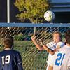 Winnacunnet's #15 gets his head on the ball off a Winnacunnet corner kick during Wednesday's NHIAA DIV I Boys Soccer game between Winnacunnet and Memorial High School on 10-5-2016 @ WHS.  Matt Parker Photos