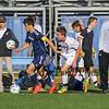 Winnacunnet's #6 Mark Fagan puts pressure on a Memorial player during Wednesday's NHIAA DIV I Boys Soccer game between Winnacunnet and Memorial High School on 10-5-2016 @ WHS.  Matt Parker Photos