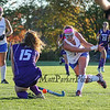 Winnacunnet's #12 Lauren Alkire takes a shot on goal with Nashua South's #15 Hannah Lambert defending during Wednesday's NHIAA DIV I Girls Field Hockey game between Winnacunnet and Nashua South High Schools on 10-5-2016 @ WHS.  Matt Parker Photos
