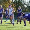 Winnacunnet's #10 Dana Sher takes the ball up the center of the field with Nashua South defenders #13 J. Coehlo and #15 Hannah Lambert putting on the pressure during Wednesday's NHIAA DIV I Girls Field Hockey game between Winnacunnet and Nashua South High Schools on 10-5-2016 @ WHS.  Matt Parker Photos