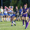 Winnacunnet's #6 Abby Merrill takes a big swing on the ball from the wing with Nashua South's #2 Olivia Montine in range of the follow through during Wednesday's NHIAA DIV I Girls Field Hockey game between Winnacunnet and Nashua South High Schools on 10-5-2016 @ WHS.  Matt Parker Photos