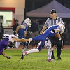 Panthers #17 Tanner Plourde holds onto the shirt tail of Winnacunnet's #3 Billy Powers but is unable to stop Powers from getting a first down during Friday Night's NHIAA DIV I Football game between Winnacunnet and Nashua South on 10-7-2016 @ WHS.  Matt Parker Photos
