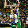 Nicks #9 Kyle O'Quinn elevates to make a shot with Celtics #44 Tyler Zeller getting a hand up to defend during the Boston Celtics vs New York Nicks NBA Basketball game on Friday 11-11-2016 @ Boston Garden, Boston, MA.  Celts-115, Nicks-87.  Matt Parker Photos