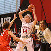 Huskies Freshman #14 Shannon Todd of York Maine looks to make a pass with Terriers #12 Sarah Hope defending and Terriers Coach calling plays during Friday's game Between Northeastern University and Boston University on 11-11-2016 @ NU.  Matt Parker Photos