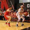 Huskies Freshman #14 Shannon Todd of York Maine looks for an outlet pass after getting trapped in the corner by Terriers #12 Sarah Hope during Friday's game Between Northeastern University and Boston University on 11-11-2016 @ NU.  Matt Parker Photos