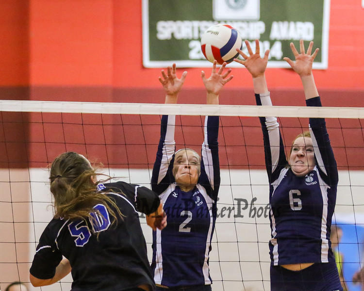 Exeter's #6 Caleigh Bousquin and #2 Kelsey Peirce jump to block a spike by Cavaliers #50 Katie Connors during Wednesday's NHIAA DIV I Semifinal game between Exeter and Hollis Brookline High Schools @ Pinkerton Academy, Derry, NH on 11-2-2016.  Matt Parker Photos
