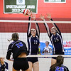 Exeter's #11 Hannah Hoffmaster and #15 Valerie Johnson jump to block a shot by Cavaliers #16 Maddie Norris during Wednesday's NHIAA DIV I Semifinal game between Exeter and Hollis Brookline High Schools @ Pinkerton Academy, Derry, NH on 11-2-2016.  Matt Parker Photos