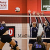 Exeter's #11 Hannah Hoffmaster and #15 Valerie Johnson jump to block a spike by Cavaliers #16 Maddie Norris during Wednesday's NHIAA DIV I Semifinal game between Exeter and Hollis Brookline High Schools @ Pinkerton Academy, Derry, NH on 11-2-2016.  Matt Parker Photos