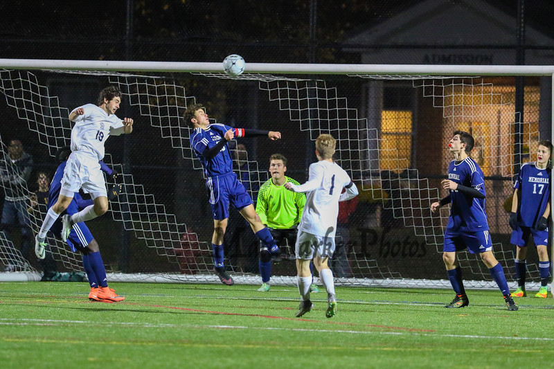 Exeter's #18 Quinn Mantegari and Memorial's #10 Santiago Rodriguez jump to get a head on the ball off an Exeter corner kick during Saturday's NHIAA DIV I Boys Soccer Championship game between Exeter and Memorial High School on Saturday 11-5-2016 @ SNHU.  EHS-5, MHS-0.  Matt Parker Photos