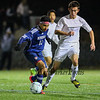 Memorial's #11 Rodrigo Rodriguez takes control  of the ball with Exeter's #7 Tucker Guen defending during Saturday's NHIAA DIV I Boys Soccer Championship game between Exeter and Memorial High School on Saturday 11-5-2016 @ SNHU.  EHS-5, MHS-0.  Matt Parker Photos