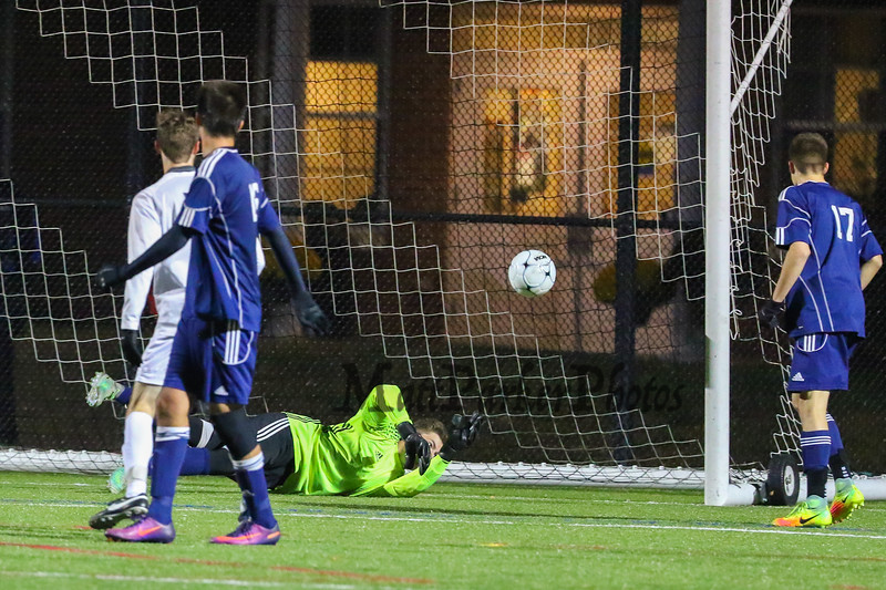 Memorial's Goal Keeper connor Page dives for the ball on a shot by Exeter's #7 Tucker Guen but is unable to make the save during Saturday's NHIAA DIV I Boys Soccer Championship game between Exeter and Memorial High School on Saturday 11-5-2016 @ SNHU.  EHS-5, MHS-0.  Matt Parker Photos