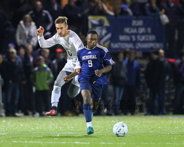 Exeter's #10 Jacob Gould chases Memorial's #9 Mbambi Mbungu down the field during Saturday's NHIAA DIV I Boys Soccer Championship game between Exeter and Memorial High School on Saturday 11-5-2016 @ SNHU.  EHS-5, MHS-0.  Matt Parker Photos