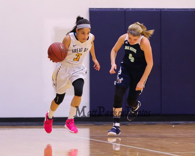 Great Bay's #3 Nichole Marrero dribbles the ball up the court with UMA's #4 Lindsey Clark trailing during Tuesday's YSCC-USCAA Woman's Basketball game between Great Bay Community College and University of Maine Agusta on 11-8-2016 @ GBCC.  Matt Parker Photos