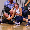 Great Bay's #21 Tasha Jarosz and UMA's #11 Hunter Chesley wrestle for a loose ball during Tuesday's YSCC-USCAA Woman's Basketball game between Great Bay Community College and University of Maine Agusta on 11-8-2016 @ GBCC.  Matt Parker Photos