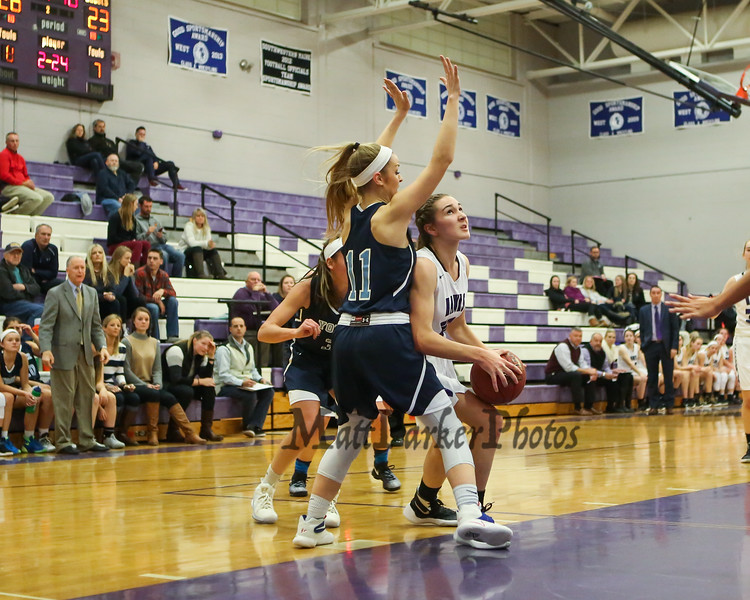 Marshwood's #10 Casey Perry looks to go under the arms of York's defender #11 Reilly Smedley for a layup while both coaches look on during Thursday's Class A South Girls Basketball game between Marshwood and York High Schools on 12-15-2016 @ MHS.  Matt Parker Photos