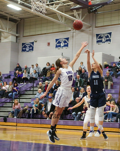 York's #11 Reilly smedley takes a jump shot from the wing with Marshwood's #10 Casey Perry getting a hand up to defend during Thursday's Class A South Girls Basketball game between Marshwood and York High Schools on 12-15-2016 @ MHS.  Matt Parker Photos