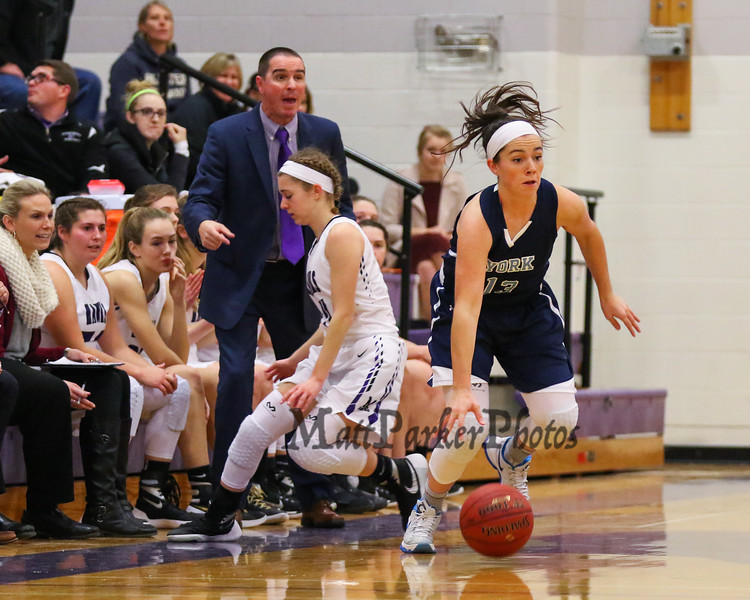 York's #13 Sophie Remick avoids a trap by Marshwood's #11 Courtney Thim during a Marshwood full-court-press with Marshwood Coach Steve Freeman calling the plays during Thursday's Class A South Girls Basketball game between Marshwood and York High Schools on 12-15-2016 @ MHS.  Matt Parker Photos
