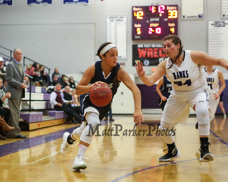 York's #21 Jackie Tabora cuts to the hoop with Marshwood's #34 Noelle Barrett defending during Thursday's Class A South Girls Basketball game between Marshwood and York High Schools on 12-15-2016 @ MHS.  Matt Parker Photos