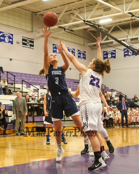 York's #3 Lily Posternak gets pressure from Marshwood defender #22  Elora Montgomery while going in for a layup during Thursday's Class A South Girls Basketball game between Marshwood and York High Schools on 12-15-2016 @ MHS.  Matt Parker Photos