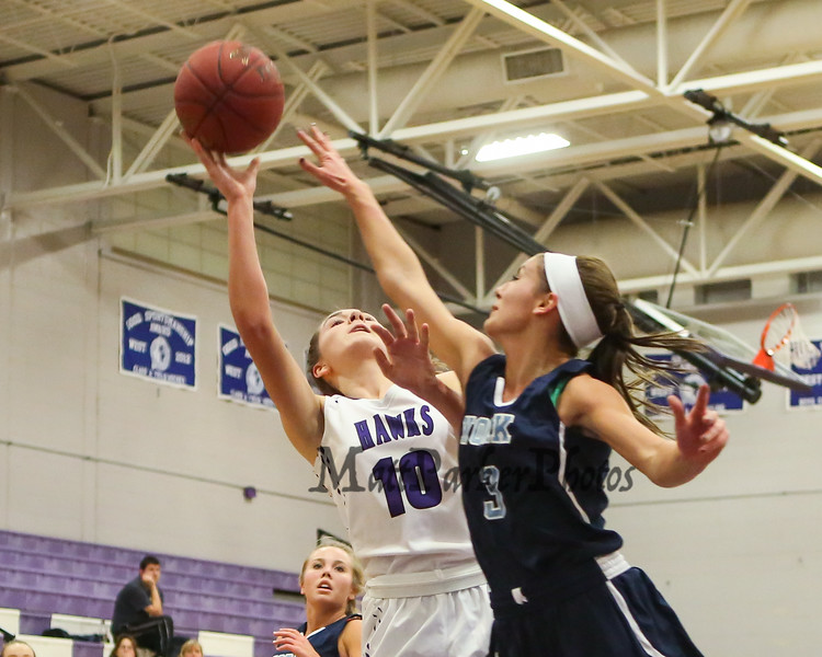 Marshwood's #10 Casey Perry gets pressure from York's #3 Lily Posternak while going up for a layup during Thursday's Class A South Girls Basketball game between Marshwood and York High Schools on 12-15-2016 @ MHS.  Matt Parker Photos