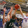 Winnacunnet's #5 Zach Waterhouse blocks a shot by Dover's #13 John Cantwell but is called for a foul with Winnacunnet's #15 Jack Schaake getting his hands up to defend during Friday Night's NHIAA DIV I Boys Basketball Home Opener between Winnacunnet and Dover High Schools on 12-16-2016 @ WHS.  Matt Parker Photos
