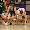 Dover's #25 Bryce Reilly makes a break up the court after controlling a loose ball with Winnacunnet's #15 Jack Schaake trailing during Friday Night's NHIAA DIV I Boys Basketball Home Opener between Winnacunnet and Dover High Schools on 12-16-2016 @ WHS.  Matt Parker Photos