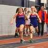 Winnacunnet's Izzy Johnson grabs the baton from Caitlin Capezzuto in the Girls 4x160 Relay where their team finished in a time of 1:39.54 at Sunday's NH Indoor Winter Track meet evening session on 12-18-2016 @ Paul Sweet Oval, UNH, Durham, NH.  Matt Parker Photos