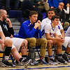 Winnacunnet's Sophmore Jack Schaake sits on the bench with his ankle in a walking cast after an injury at Monday's practice during Tuesday's NHIAA DIV I Boys Basketball game between Winnacunnet and Keene High Schools on 12-20-2015 @ WHS.  Matt Parker Photos
