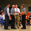 The Referees discuss a call with Blackbirds Coach Kevin Ritter and Winnacunnet's Coach Jay McKenna after it appeared that a fan touched the ball before it went out of bounds during Tuesday's NHIAA DIV I Boys Basketball game between Winnacunnet and Keene High Schools on 12-20-2015 @ WHS.  Matt Parker Photos