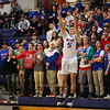 Winnacunnet's #5 Zach Waterhouse takes a 3-pointer from the WHS student cheering section during Tuesday's NHIAA DIV I Boys Basketball game between Winnacunnet and Keene High Schools on 12-20-2015 @ WHS.  Matt Parker Photos