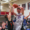 Winnacunnet's #21 Logan Keene gets pressure from Keene's #35 Dylan Grover and #33 Jake Blaisdell committing a foul from behind while driving to the hoop during Tuesday's NHIAA DIV I Boys Basketball game between Winnacunnet and Keene High Schools on 12-20-2015 @ WHS.  Matt Parker Photos